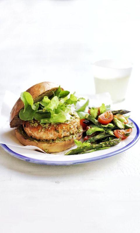 pesto salmon burgers with asparagus and tomato salad