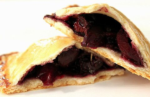 """These portable desserts combine pie crust with a cherry-and-dark chocolate filling. The finishing touch: Coat them in a light powdered sugar and vanilla glaze.  <strong>Get the recipe from <a target=""""_blank"""" href=""""http://www.melecotte.com/2013/06/chocolate_cherry_hand_pies/"""">Melle Cotte</a>.</strong>"""