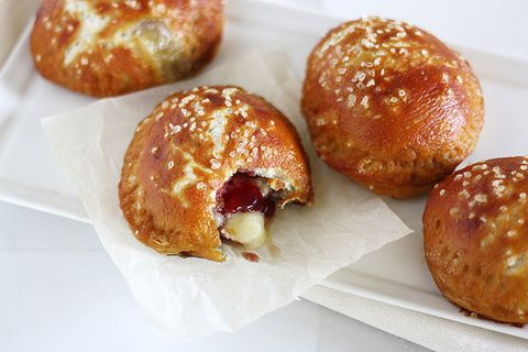 """Pretzel dough filled with raspberry jam and a wedge of soft, melty Brie cheese baked to warm, gooey perfection? You'll want to eat these fresh out of the oven.   <strong>Get the recipe from <a target=""""_blank"""" href=""""http://www.girlversusdough.com/2013/08/05/brie-jam-pretzel-hand-pies/"""">Girl Versus Dough</a>.</strong>"""