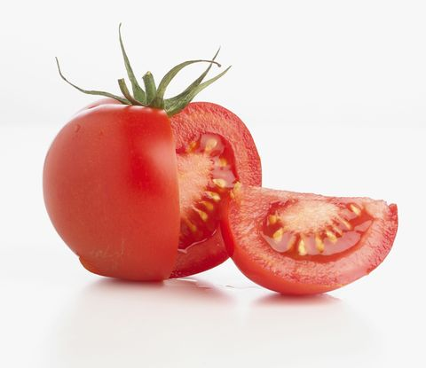 Tomato with a segment cut off