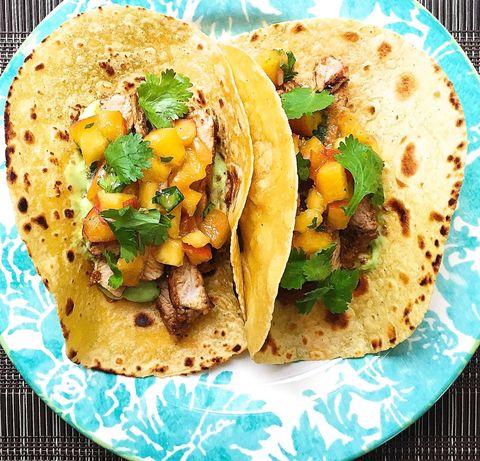 spiced pork tacos with avocado crema and peach salsa