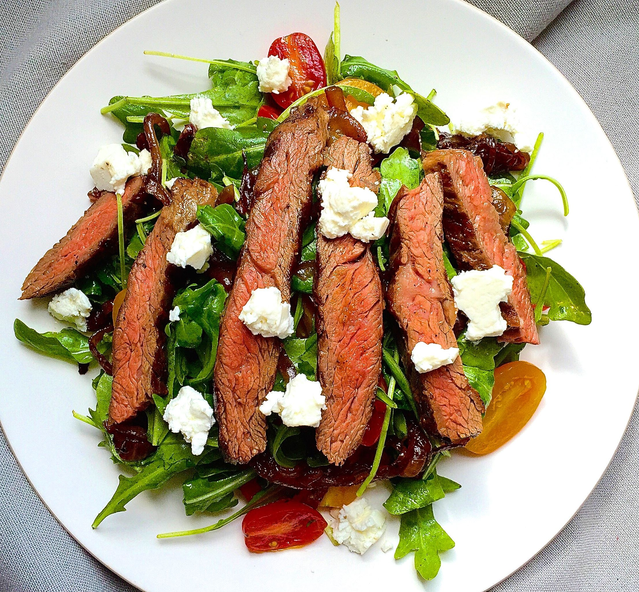 Grilled Skirt Steak Salad With Arugula Balsamic Glazed Onions Tomatoes And Feta Recipe Delish Com