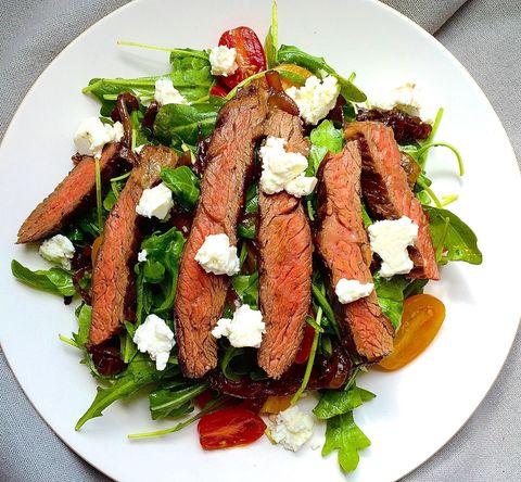 grilled skirt steak salad with arugula, balsamic glazed onions, tomatoes, and feta