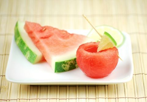 """<p>Scoop out watermelon with an ice cream scooper, hollow out the center, and pour in your alcohol of choice for a refreshing drink on a hot summer day.</p> <p>Get the recipe at <a target=""""_blank"""" href=""""http://www.sheknows.com/food-and-recipes/articles/968495/3-edible-shot-glasses"""">She Knows</a>.</p>"""