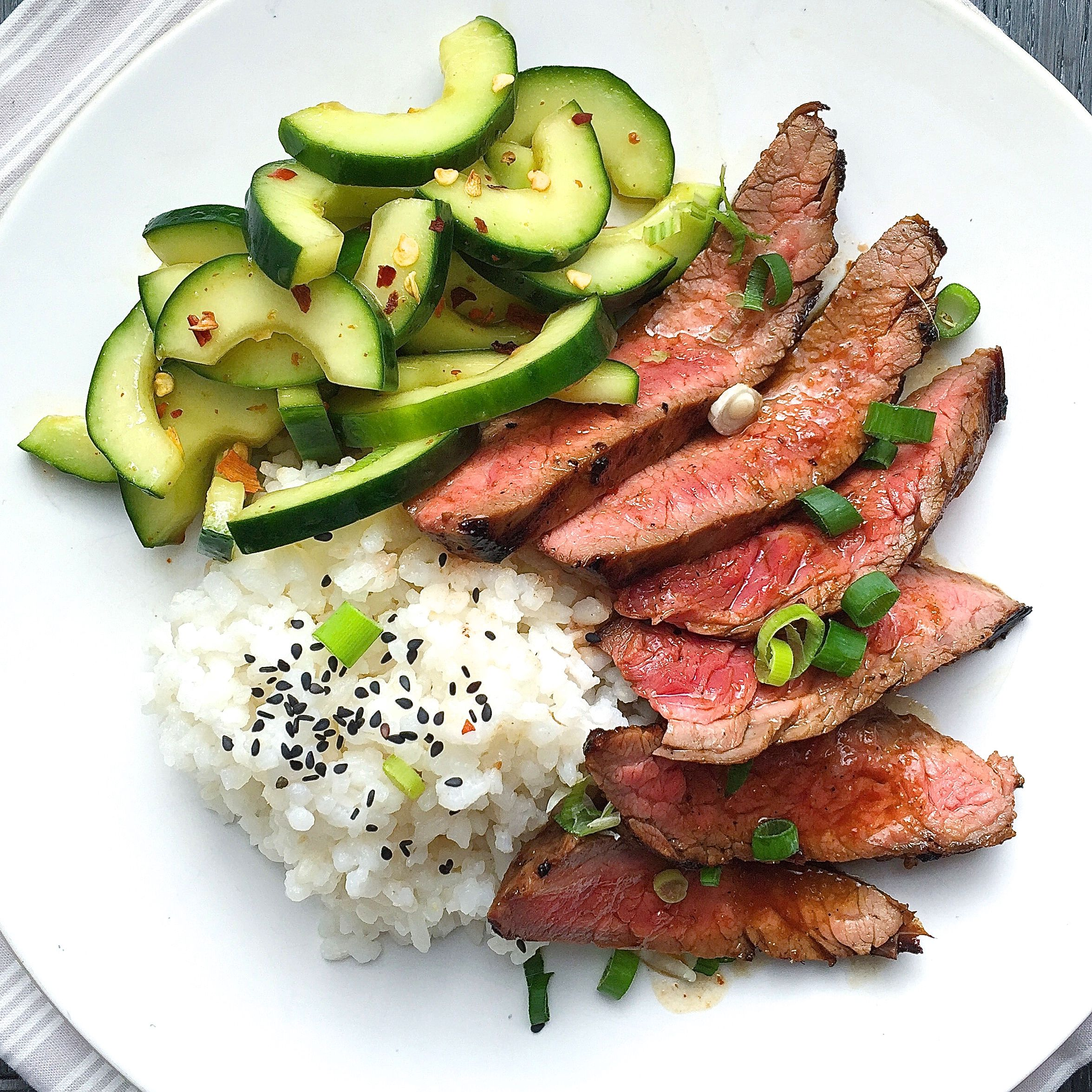 best korean-style grilled flank steak with sticky rice and spicy