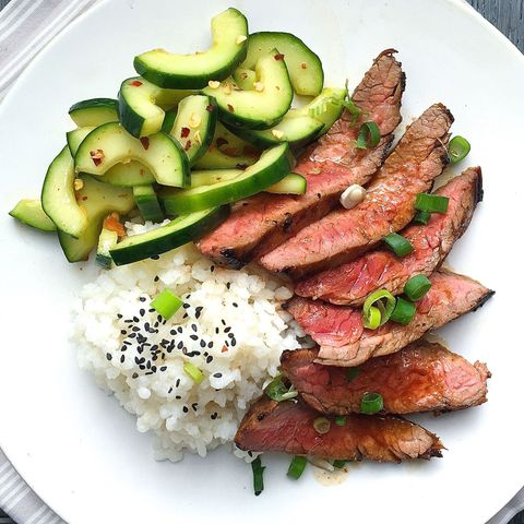 korean style grilled flank steak with sticky rice and spicy cucumber salad