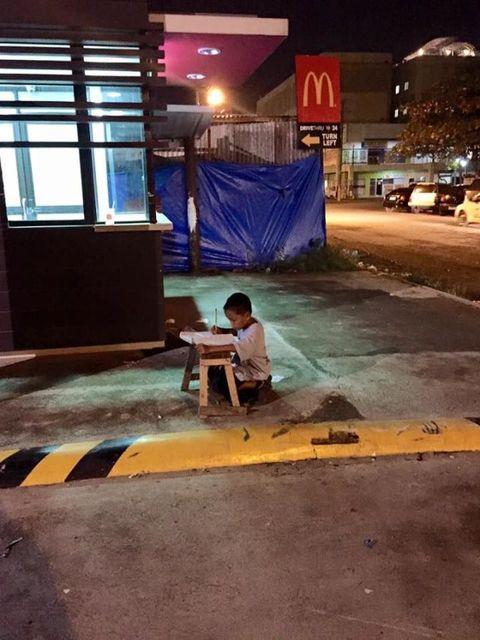 Homeless Boy Uses McDonald's Light to Do Homework
