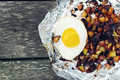 """<p><a href=""""http://www.delish.com/cooking/recipe-ideas/recipes/a43191/foil-pack-potato-hash-with-fried-egg/"""">Get the recipe</a><br></p>"""