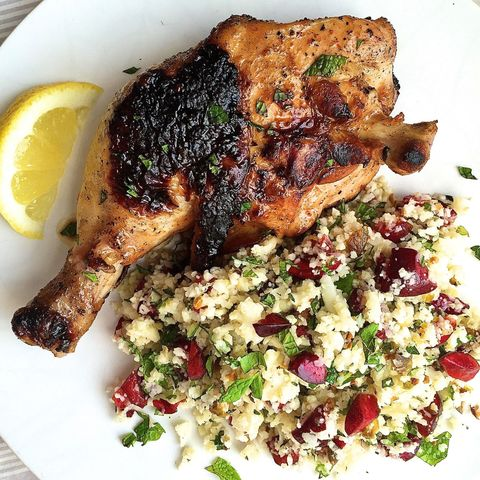 spicy chicken legs and cauliflower couscous with cherries, pistachios, and mint