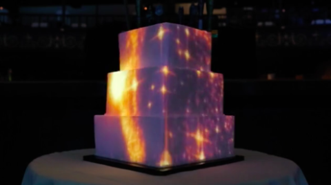 Video mapped wedding cakedelish over the top wedding cakes are having a moment right now but nothing says we got married in 2015 quite like a video cake keep your guests entertained junglespirit Gallery
