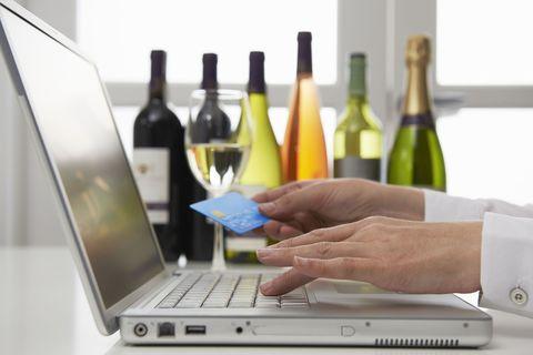 Bottle, Wine bottle, Product, Alcohol, Laptop, Technology, Electronic device, Wine, Finger, Drinkware,