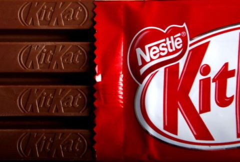 Brown, Confectionery, Font, Logo, Chocolate, Sweetness, Chocolate bar, Dessert, Snack,