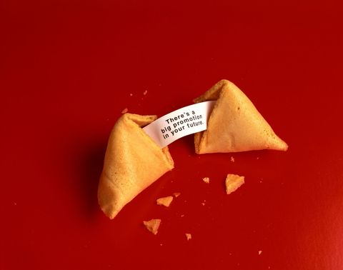 Red, Food, Paper product, Fortune cookie, Carmine, Paper, Cuisine, Sweetness, Cone, Triangle,