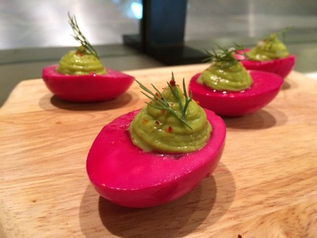 "<p>These eggs are pickled in beet juice, giving the whites a purple tint—and distinct, tangy flavor—and they're topped with chive crème fraîche. You'll want to Hulk Smash them into your mouth. Immediately. Find them at <a href=""http://gothamwestmarket.com/#vendors"" target=""_blank"">El Comado in Gotham West Market</a>.</p>"