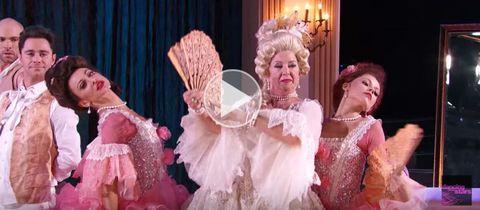 Entertainment, Performing arts, Pink, Headgear, Costume design, Fashion, Costume, Chandelier, Light fixture, Embellishment,