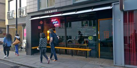 Window, Jeans, Public space, Bench, Sidewalk, Jacket, Street fashion, Pedestrian, Signage, Commercial building,