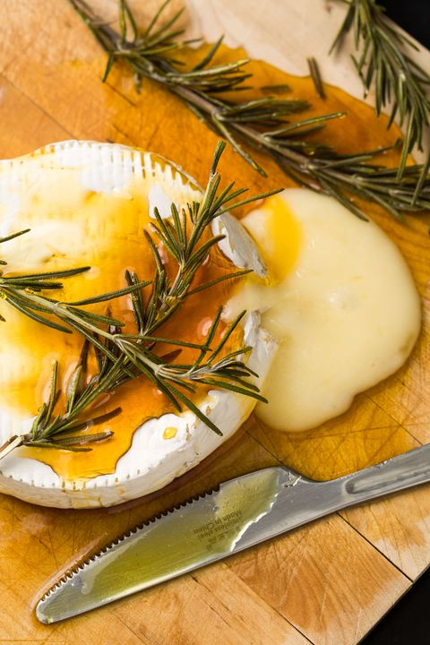 It takes a minute flat to dress up a wheel of brie; all it needs is a drizzle of honey and few sprigs of rosemary for a festive flair.