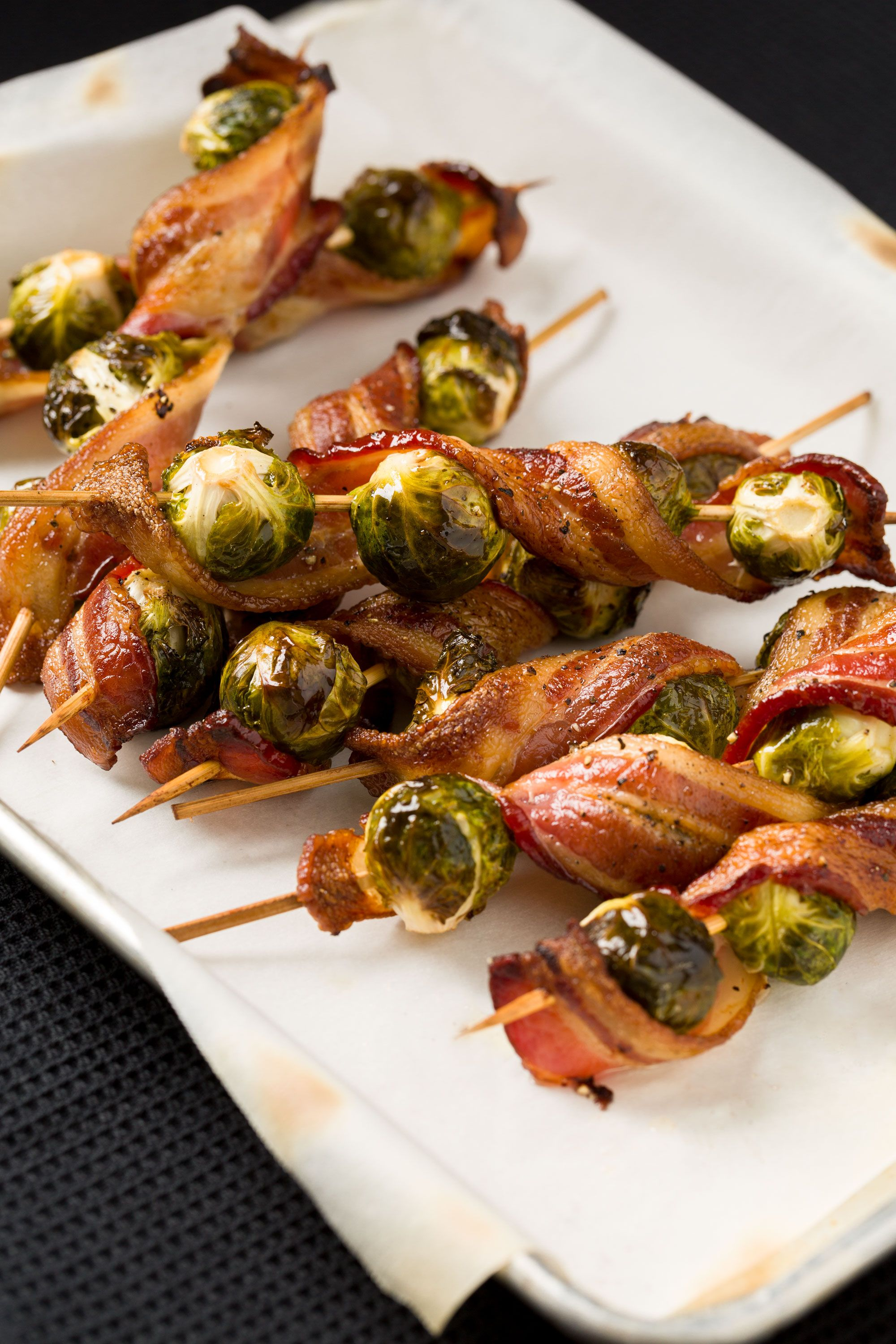 "<p>Over the bacon trend? Pssh. Twirl slices around Brussels sprouts for a finger food to remember.</p><p>Get the recipe on <a target=""_blank"" href=""http://www.delish.com/entertaining/tabletop/recipes/a44512/bacon-brussels-sprout-skewers-recipe/"">Delish</a>.<br></p>"