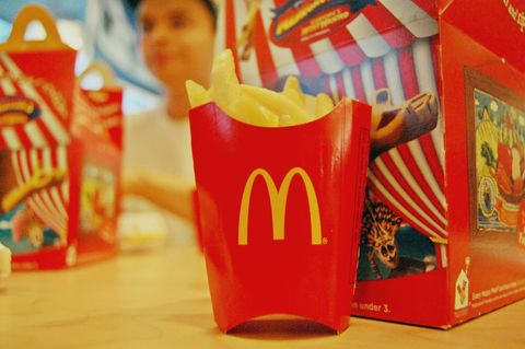 French fries, Paper product, Side dish, Paper bag, Fried food, Paper, Present, Junk food, Plastic, Packaging and labeling,