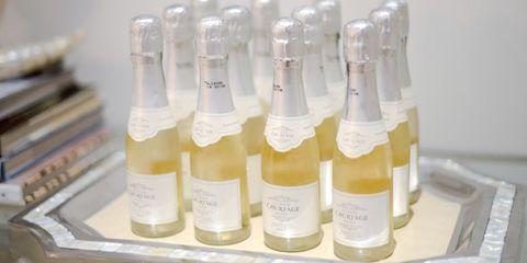 Liquid, Product, Fluid, Bottle, Bottle cap, Glass bottle, Solution, Packaging and labeling, Solvent, Plastic,
