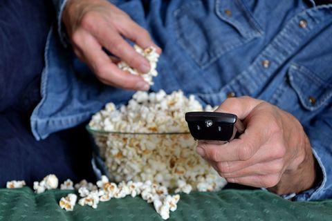 Finger, Denim, Hand, Wrist, Popcorn, Nail, Thumb, Kettle corn, Mobile phone, Gadget,