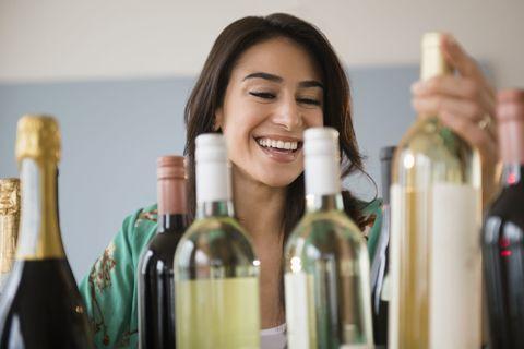 Smile, Product, Glass bottle, Bottle, Alcohol, Drink, Alcoholic beverage, Happy, Drinkware, Wine bottle,