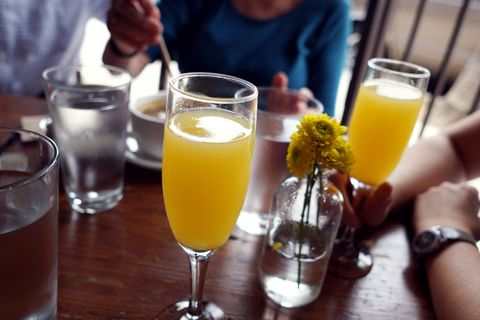 Yellow, Drink, Tableware, Barware, Glass, Watch, Juice, Drinkware, Table, Orange juice,