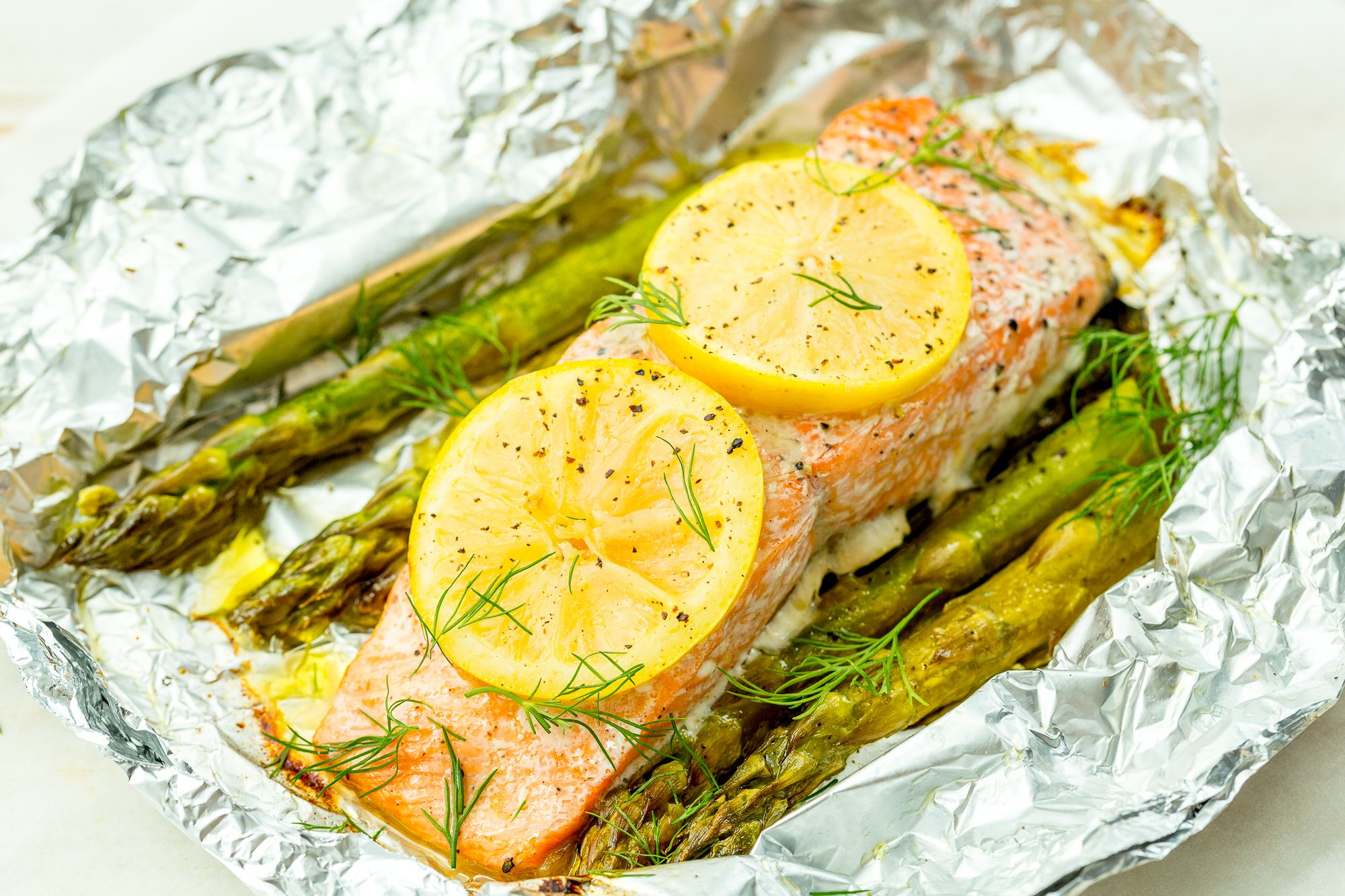 Best Grilled Salmon In Foil Recipe How To Grill Salmon Foil Packets With Asparagus Delish Com