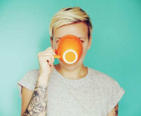 Woman drinking coffee from mug