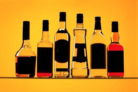 Product, Liquid, Yellow, Bottle, Glass bottle, Line, Bottle cap, Amber, Drink, Orange,