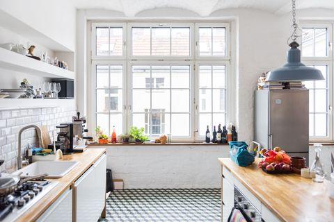 Room, Interior design, Countertop, Kitchen, Floor, Home, Interior design, Gas stove, Kitchen stove, House,