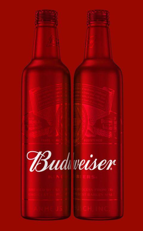 Liquid, Glass bottle, Fluid, Bottle, Red, Drink, Drinkware, Glass, Alcoholic beverage, Logo,