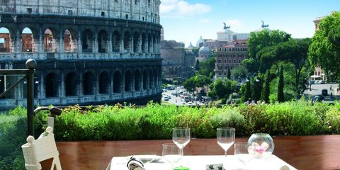 Tablecloth, Table, Furniture, Outdoor furniture, Outdoor table, Linens, Ancient rome, Wine glass, Stemware, Amphitheatre,
