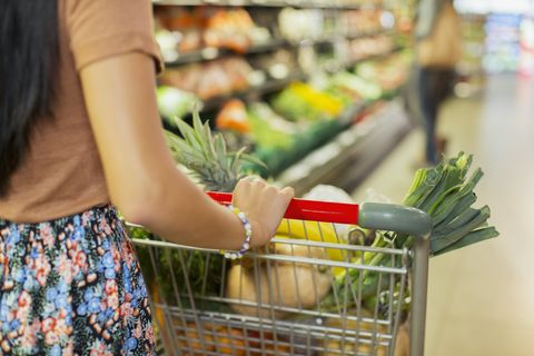 Woman pushing cart at grocery store