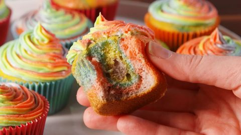 How To Make Rainbow Cupcakes Rainbow Frosting Hack Video Delish Com