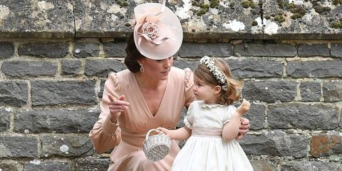 Clothing, Hat, Brick, Dress, Fashion accessory, Wall, Headgear, Sun hat, Costume accessory, Embellishment,