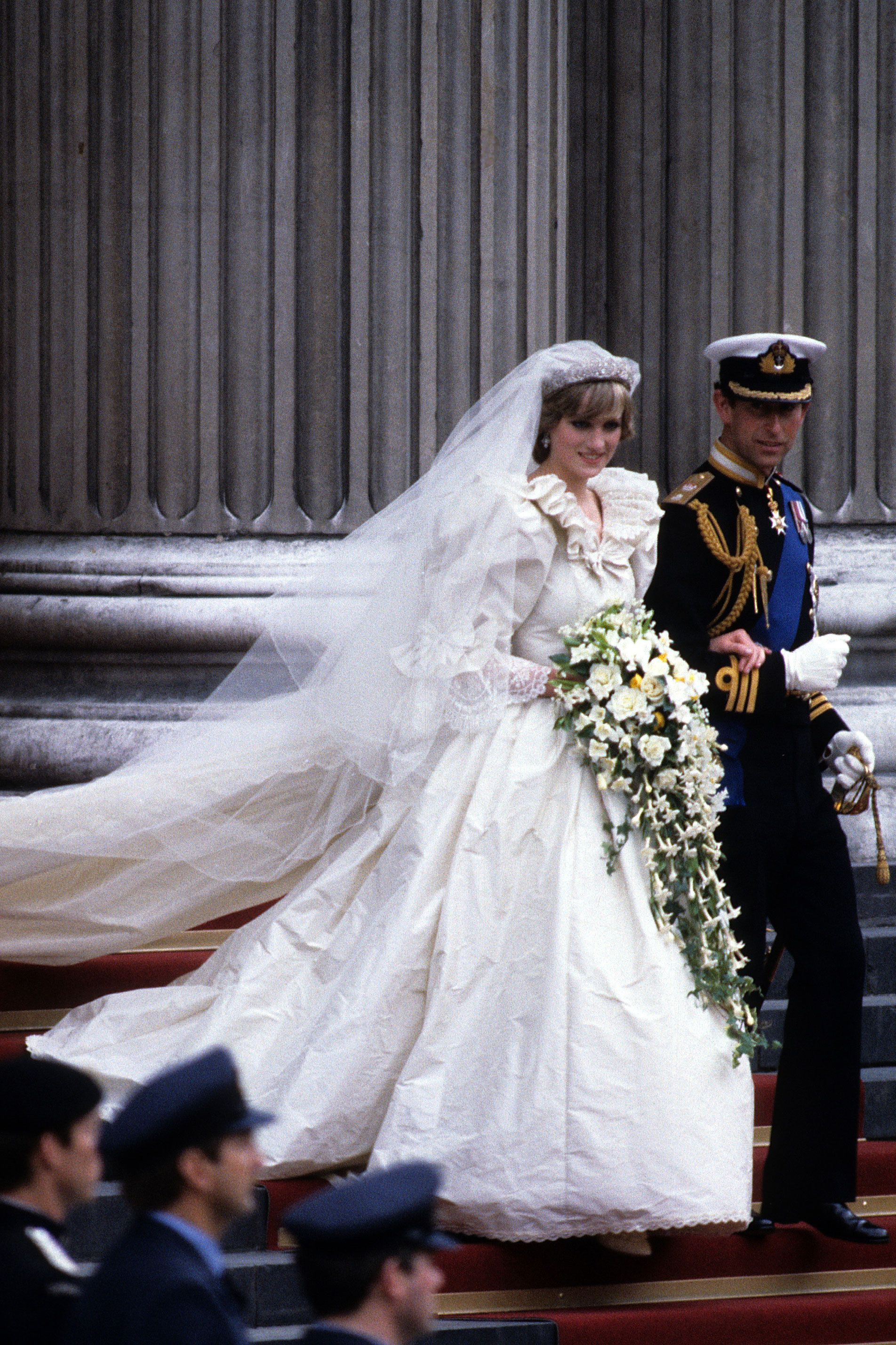 """<p>Diana's wedding gown, in all its 1980s glory, was instantly iconic after her nuptials aired to an estimated TV audience of 750 million.</p><p><strong data-redactor-tag=""""strong"""" data-verified=""""redactor"""">RELATED: </strong><a href=""""http://www.redbookmag.com/love-sex/relationships/news/g4459/princess-diana-prince-charles-rare-wedding-photos/"""" target=""""_blank"""" data-tracking-id=""""recirc-text-link""""><strong data-redactor-tag=""""strong"""" data-verified=""""redactor"""">Rare Photos From Princess Diana and Prince Charles' Wedding Released</strong></a></p>"""