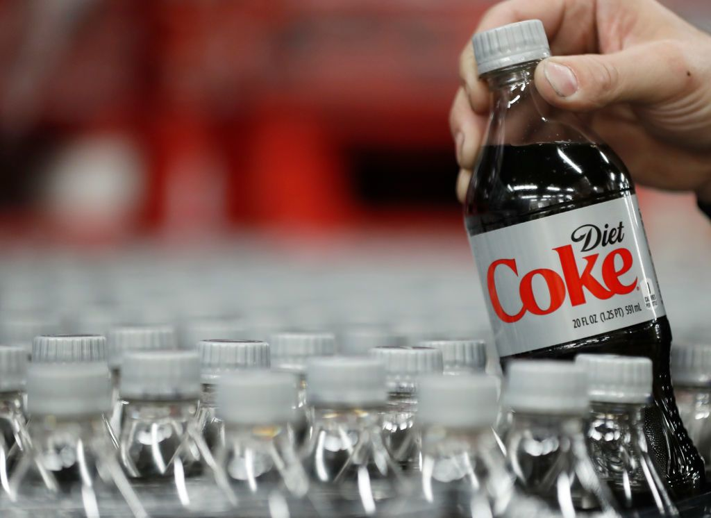 Why You Should Never Order Diet Coke On A Plane