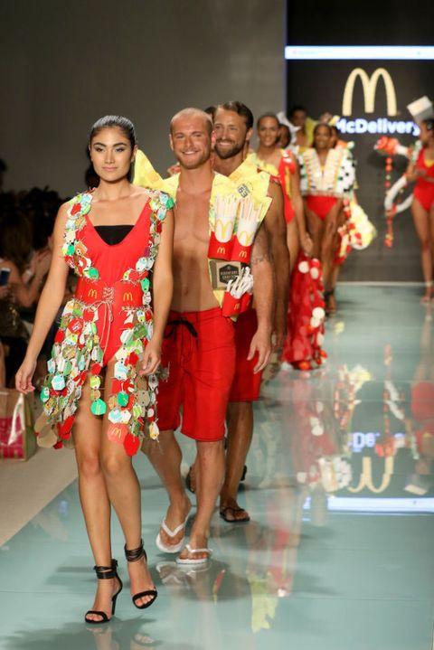 Leg, Event, Dress, Red, Human leg, Fashion model, Fashion show, One-piece garment, Runway, Fashion,