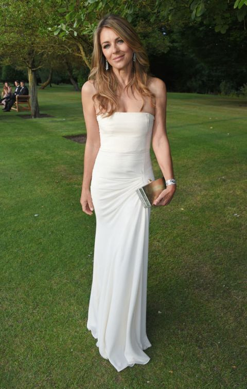 Clothing, Green, Dress, Shoulder, Textile, Photograph, Joint, Bridal clothing, Formal wear, Gown,