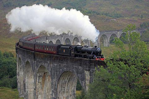 Transport, Steam engine, Steam, Viaduct, Locomotive, Arch bridge, Train, Railway, Vehicle, Rolling stock,