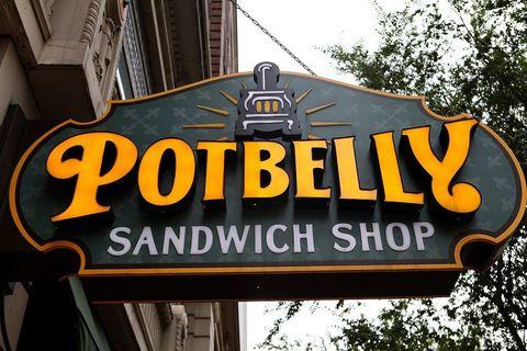 Signage, Font, Sign, Street sign, Restaurant, Electronic signage, Building,
