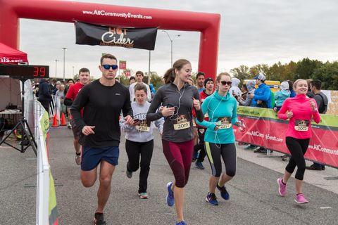 Athlete, Running, Red, Recreation, Marathon, Outdoor recreation, Long-distance running, Individual sports, Half marathon, Sports,