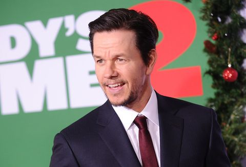 Forehead, Suit, White-collar worker, Premiere, Event, Facial hair, Official, Spokesperson, Smile, Businessperson,