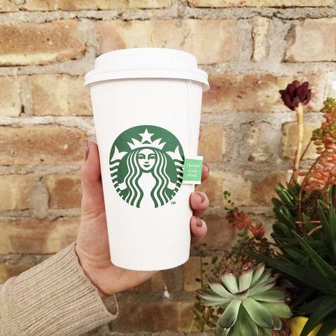 Coffee cup, Cup, Drinkware, Coffee cup sleeve, Plant, Hand, Cup, Tableware, Mug, Symbol,