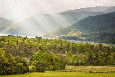 Highland, Natural landscape, Nature, Mountainous landforms, Sky, Green, Hill, Mountain, Atmospheric phenomenon, Vegetation,