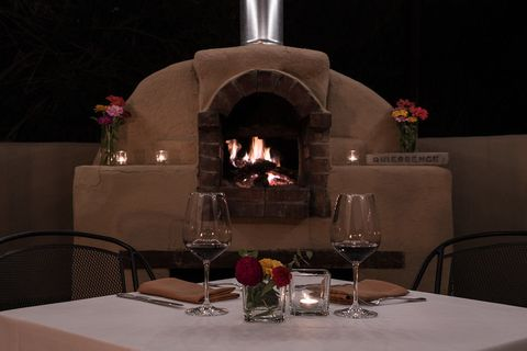 Fireplace, Restaurant, Masonry oven, Hearth, Heat, Design, Room, Interior design, Table, Furniture,
