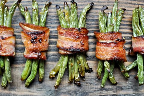 "<p>Brush on brown sugar and garlic, tie together with bacon, and green beans transform into to a savory, crispy veggie treat.</p> <p>Get the recipe at <a href=""http://www.howsweeteats.com/2011/06/green-bean-bacon-bundles/"" target=""_blank"">How Sweet It Is</a>.</p>"