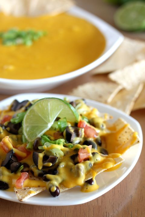 """<p>Not only is this recipe gluten-free, it's also vegan, soy-, nut-, and corn-free, meaning no one will find anything to not like. Drizzle over nachos or use as a dipping sauce for veggies like broccoli and cauliflower.</p> <p>Get the recipe at <a href=""""http://veganyumminess.com/vegan-nacho-cheese/"""">Vegan Yumminess</a>.</p>"""