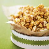 "<p>In pursuit of the perfectly easy holiday gift, we dreamed up this rich caramel-covered snack of salted peanuts and fresh-popped corn. Buy a few pretty tins to serve up this gift in style.</p><p><b>Recipe:</b> <a href=""/recipefinder/caramel-crunch-holiday-gifts-recipes""><b>Caramel Crunch</b></a></p>"